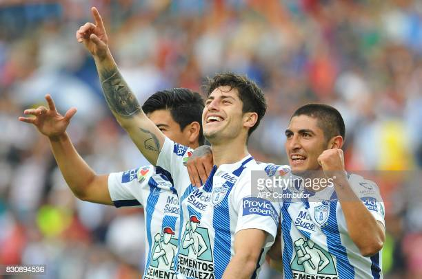 Angelo Sagal of Pachuca celebrates with teammates his goal against Tigres during their Mexican Apertura 2017 Tournament football match at Hidalgo...