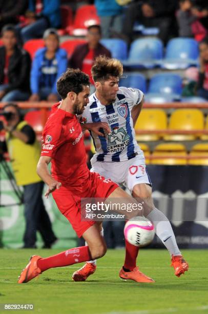 Angelo Sagal of Pachuca vies for the ball with Argentine player Santiago Garcia of Toluca during their Mexican Apertura tournament match at the...
