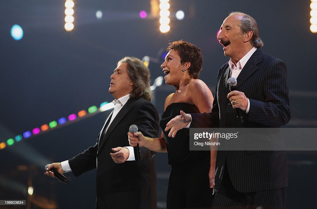 Angelo Sotgiu, Angela Brambati, Franco Gatti from Italian pop music group 'Ricchi e Poveri' attend the 'Disco Of The 80th Rock & Dance' in Olympisky on November 24, 2012 in Moscow, Russia.
