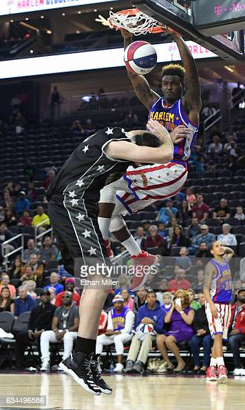 Angelo 'Spider' Sharpless of the Harlem Globetrotters dunks over 'Cager' #0 of the World AllStars during their exhibition game at TMobile Arena on...