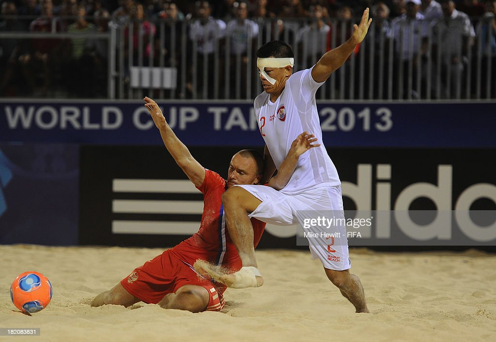 Angelo Tchen of Tahiti challenges Egor Eremeev of Russia during the FIFA Beach Soccer World Cup Tahiti 2013 Semi Final match between Russia and Tahiti at the Tahua To'ata Stadium on September 27, 2013 in Papeete, French Polynesia.