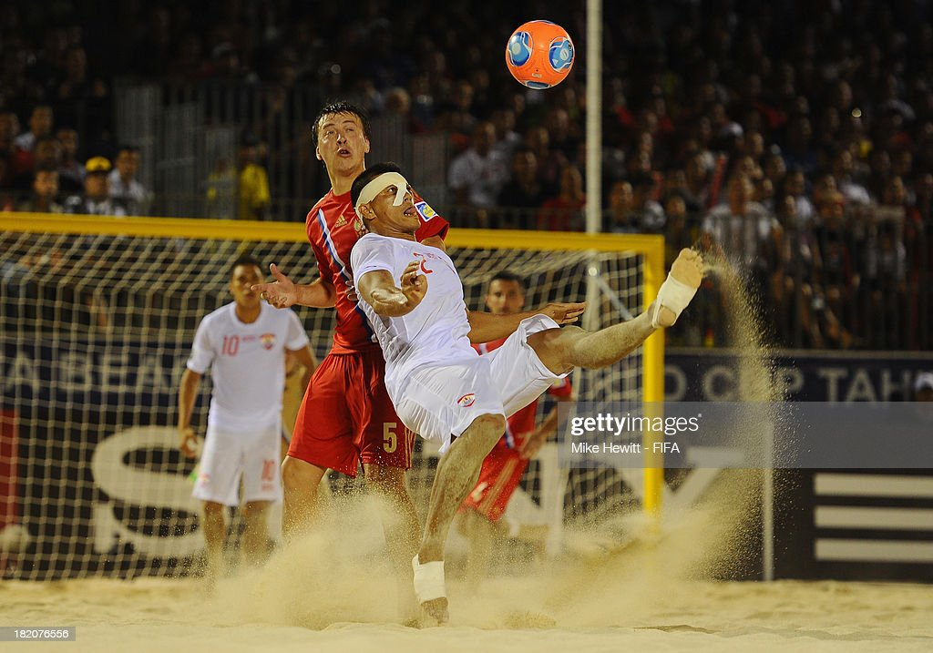 Angelo Tchen of Tahiti is challenged by Yury Krasheninnikov of Russia during the FIFA Beach Soccer World Cup Tahiti 2013 Semi Final match between Russia and Tahiti at the Tahua To'ata Stadium on September 27, 2013 in Papeete, French Polynesia.
