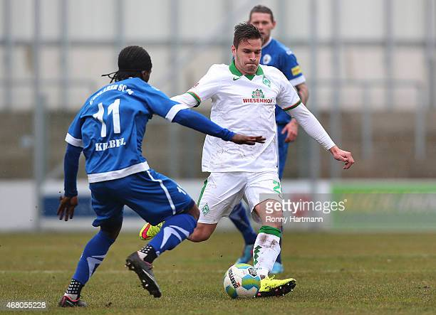 Angelos Argyris of Bremen and George Kelbel of Goslar compete during the Regionalliga Nord match between Goslarer SC 08 and Werder Bremen II at...