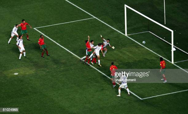 Angelos Charisteas of Greece scores their winning goal during the UEFA Euro 2004 Final match between Portugal and Greece at the Luz Stadium on July 4...