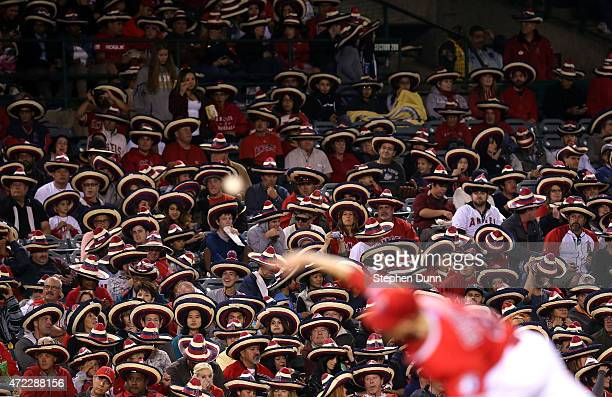 Angels fans take part in a Cinco de Mayo promotion by wearing giveaway sombreros and setting a Guinness World record for 'largest gathering of people...