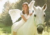 Angels girl on white horse