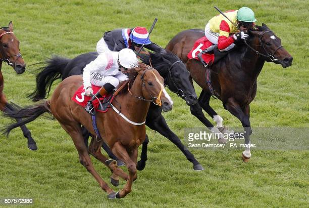 Angels Pursuit ridden by jockey Richard Hughes goes on to win the Berkshire County Blind Society Carnarvon stakes at Newbury Racecourse