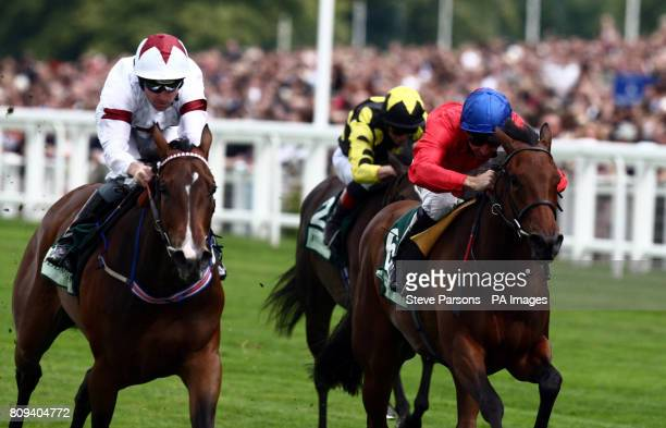 Angels will Fall ridden by Robert Winston beats Regal Realm in the Princess Margaret Juddmonte Stakes during the Betfair Weekend at Ascot Racecourse...