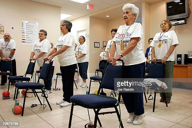 Angeolina Menendez and Antonia Perez listen to an exercise instructor during a workout at the CACFlorida medical center March 22 2007 in Miami...