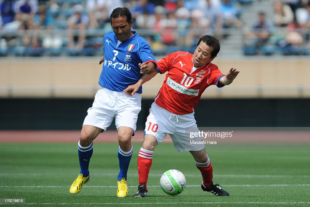Angero Di Livio #7 (L) and Kazushi Kimura #10 compete for the ball during the J.League Legend and Glorie Azzurre match at the National Stadium on June 9, 2013 in Tokyo, Japan.