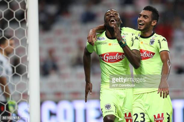 Angers' Cameroonian forward Karl Toko Ekambi celebrates after scoring a goal during the French L1 football match Nice vs Angers on September 22 at...