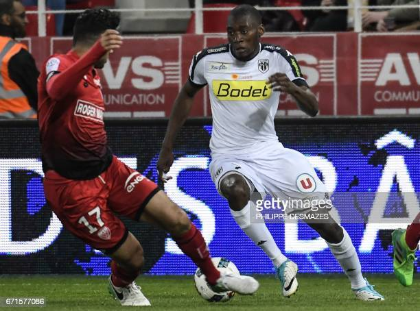 Angers' Cameroonian forward Karl Toko Ekambi vies with Dijon's Algerian midfielder Mehdi Abeid during the French L1 football match between Dijon FCO...