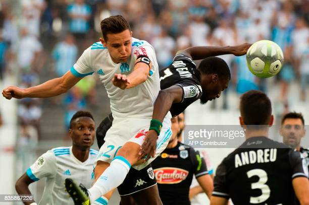 TOPSHOT Angers' Cameroonian forward Karl Toko Ekambi vies with Olympique de Marseille's French midfielder Florian Thauvin during the French Ligue 1...