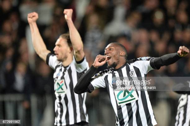 Angers' Cameroun forward Karl Toko Ekambi reacts after scoring during the French Cup semifinal football match between Angers and Guingamp on April 25...