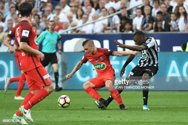 Angers' Cameroun forward Karl Toko Ekambi vies for the ball with Paris SaintGermain's Italian midfielder Marco Verratti during the French Cup final...