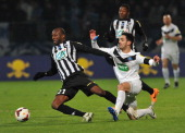Angers' Djibril Konate vies with Moulins' Sebastien Da Silva during a French Cup quarter final football match between Moulins and Angers on March 25...