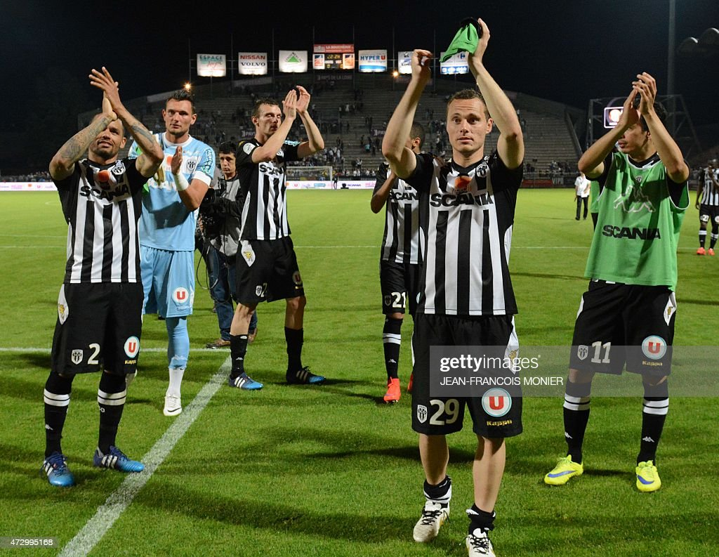 Angers' French defender Gael Angoula Angers' French Goalkeeper Alexandre Letellier Angers' French midfielder Vincent Manceau Angers' French...