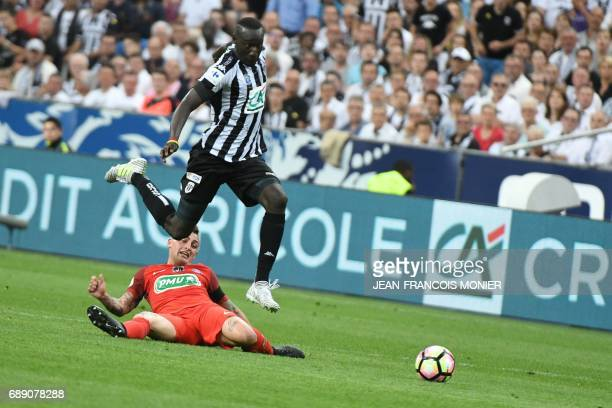 Angers' French defender Issa Cissokho jumps ove Paris SaintGermain's Italian midfielder Marco Verratti during the French Cup final football match...