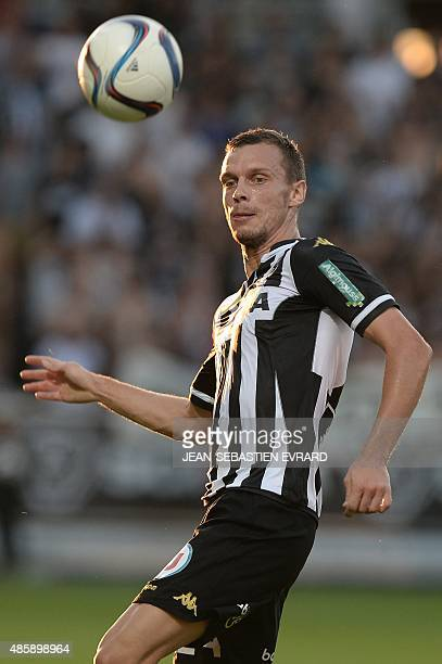 Angers' French defender Romain Thomas runs with the ball during the French L1 football match between Angers and Nice on August 29 2015 at the Jean...