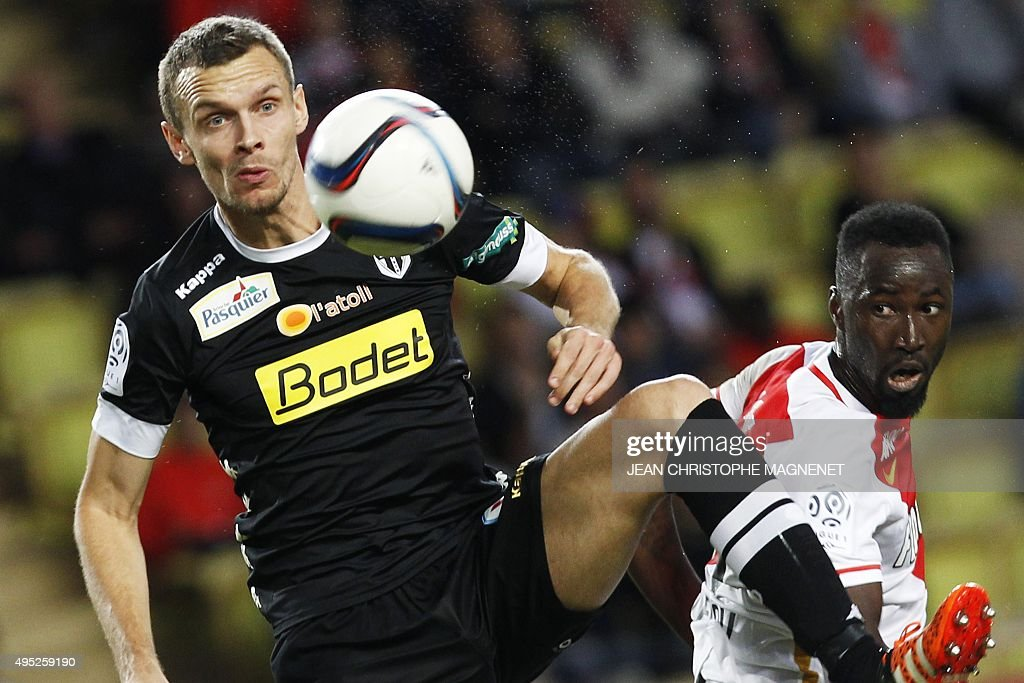 Angers' French defender Romain Thomas vies with with Monaco's Ivoirian forward Lacina Traore during the French L1 football match between Monaco and...