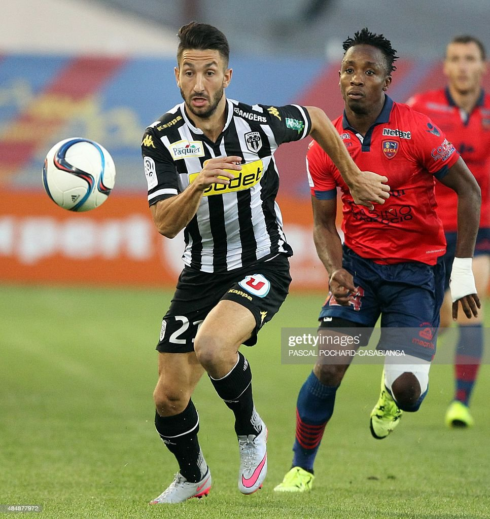 Angers' French defender Yoann Andreu vies with Ajaccio's FrancoCongolese forward John Tshibumbu during the French L1 football match GFC Ajaccio...