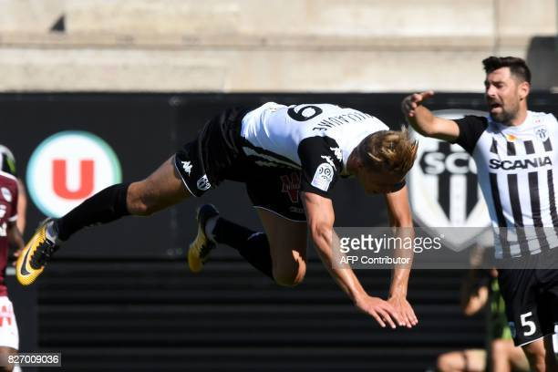 Angers' French forward Baptiste Guillaume falls during the French L1 football match between Angers and Bordeaux at RaymondKopa Stadium in Angers on...