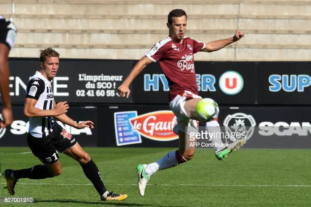 Angers' French forward Baptiste Guillaume vies for the ball with Bordeaux's Serbian defender Vukasin Jovanovic during the French L1 football match...