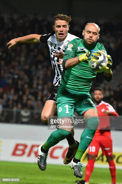 Angers' French forward Baptiste Guillaume vies Nancy's French goalkeeper Sergey Chernik during the French League Cup round of 16 football match...