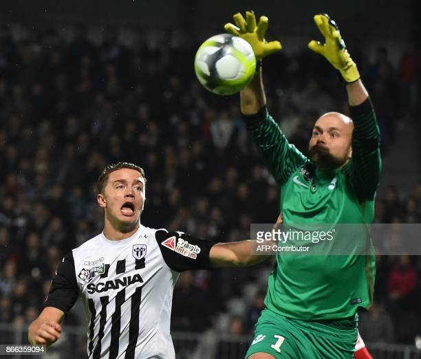 Angers' French forward Baptiste Guillaume vies Nancy's French goalkeeper Sergey Chernik during the French League Cup roud of 16 football match...