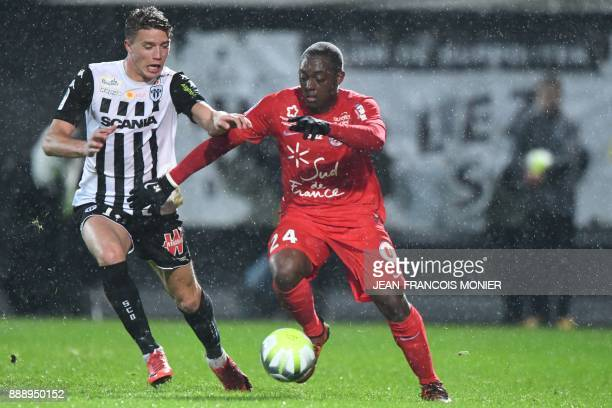 Angers' French forward Baptiste Guillaume vies with Montpellier's French defender Jerome Roussillon during the French L1 Football match between...