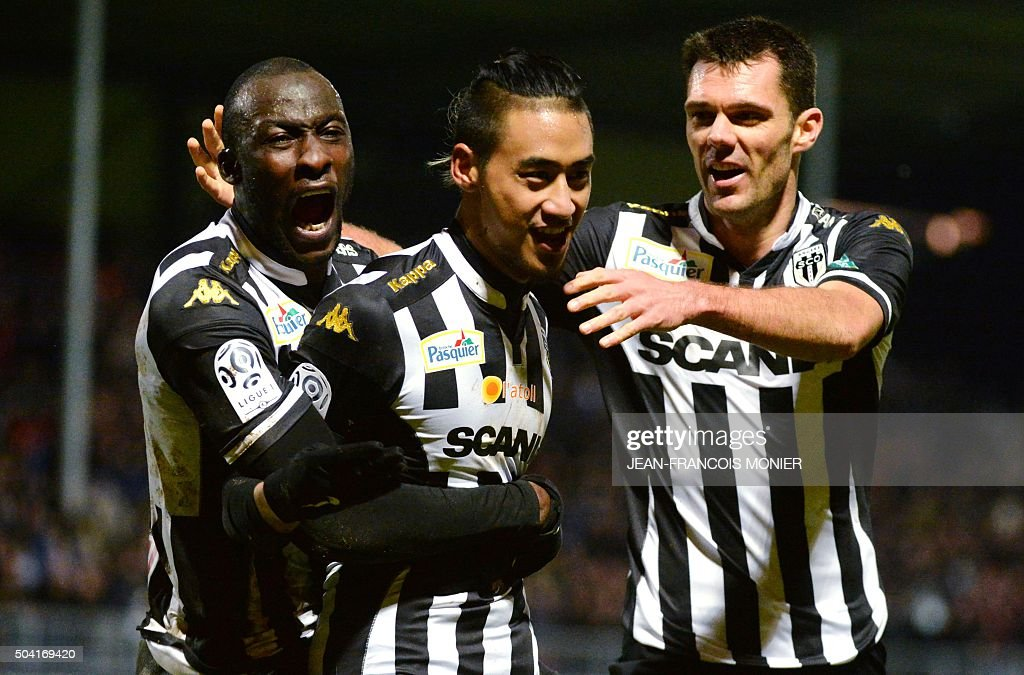 Angers' French forward Billy Ketkeophomphone is congratulated by temmates Angers' Guinean defender Ibrahima Diallo and Angers' French midfielder...