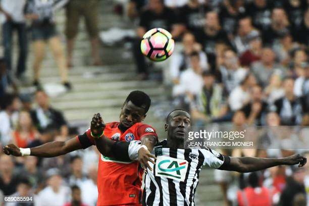 Angers' French forward Famara Diedhiou jumps for the ball with Paris SaintGermain's Ivorian defender Serge Aurier during the French Cup final...