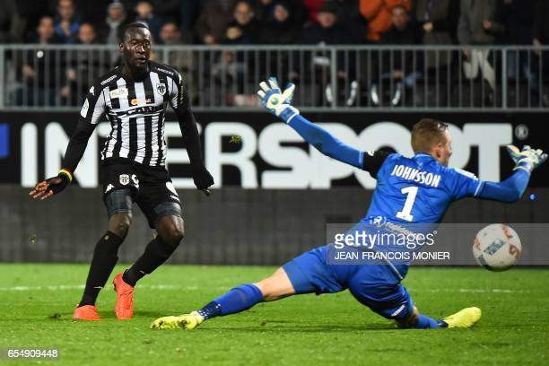 Angers' French forward Famara Diedhiou shoots and scores despite of Guingamp's Danish goalkeeper KarlJohan Johnsson during the French L1 football...
