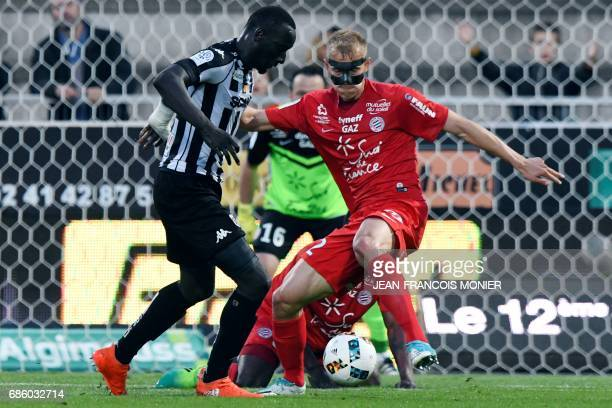 Angers' French forward Famara Diedhiou vies for the ball with Montpellier's Czech defender Lukas Pokorny during the French L1 football match between...