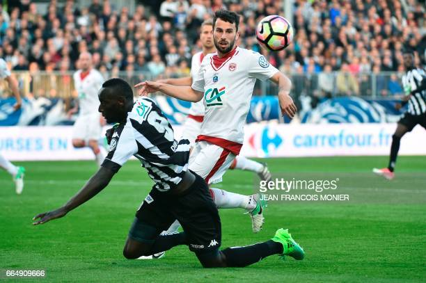 Angers' French forward Famara Diedhiou vies for the ball with Bordeaux's Serbian defender Milan Gajic during the quarter final French Cup football...