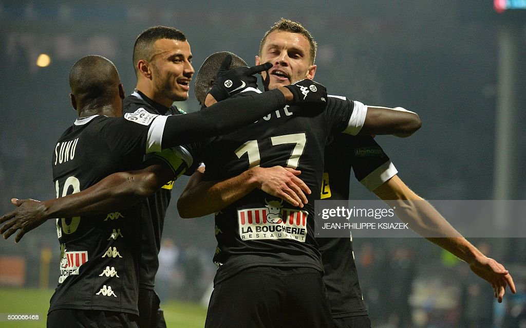 Angers' French forward Gilles Sunu Angers' Moroccan midfielder Romain Saiss Angers' Senegalese midfielder Cheikh N'Doye and Angers' French defender...