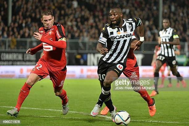 Angers' French forward Gilles Sunu evades Rennes' French defender Sylvain Armand during the French L1 football match between Angers and Rennes on...