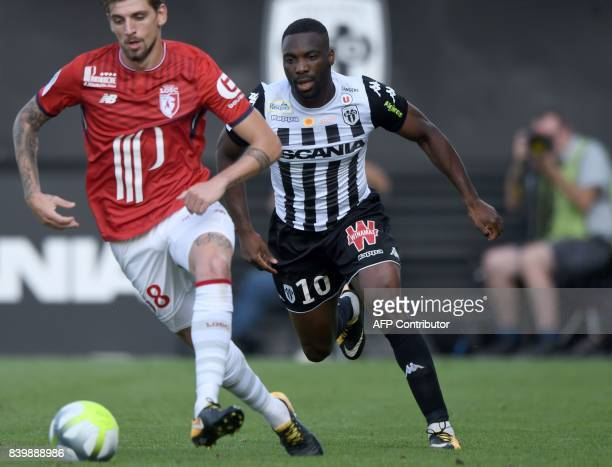 Angers' French forward Gilles Sunu fights for the ball with Lille's Portuguese midfielder Xeka during the French L1 football match between Angers and...