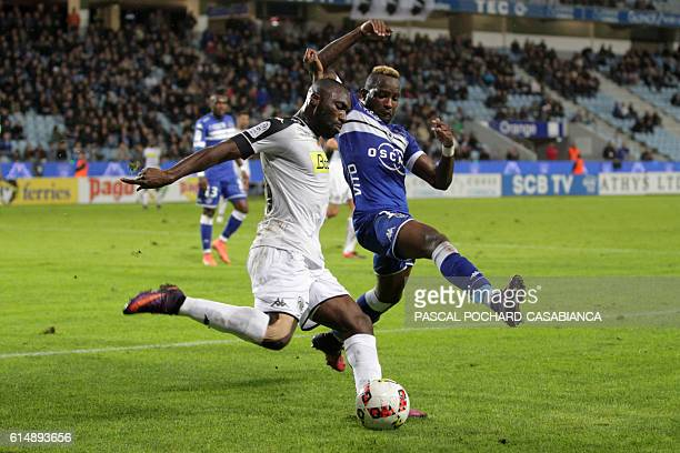 Angers' French forward Gilles Sunu vies with Bastia's French midfielder Lenny Nangis during the French L1 football match between Bastia and Angers on...
