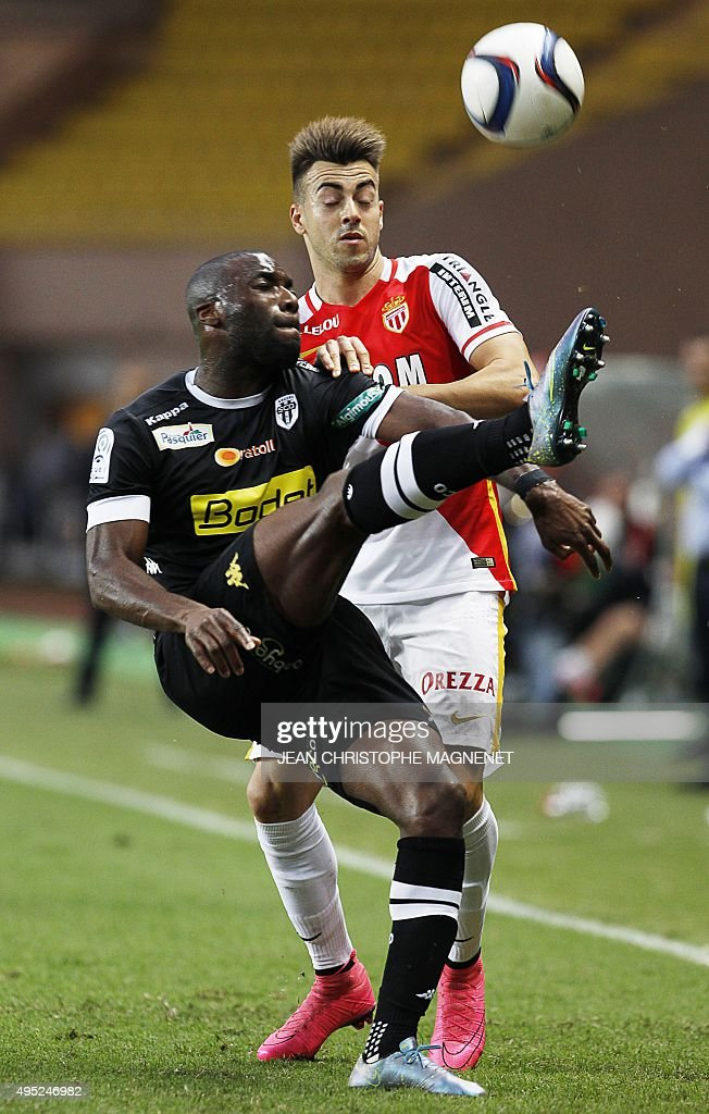 Angers' French forward Gilles Sunu vies with Monaco's Italian forward Stephan El Shaarawy during the French L1 football match Monaco against Angers...