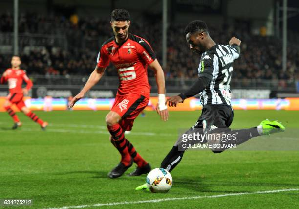 Angers' French forward Jonathan Bamba vies for the ball with Rennes' Algerian defender Ramy Bensebaini during the French L1 football match between...
