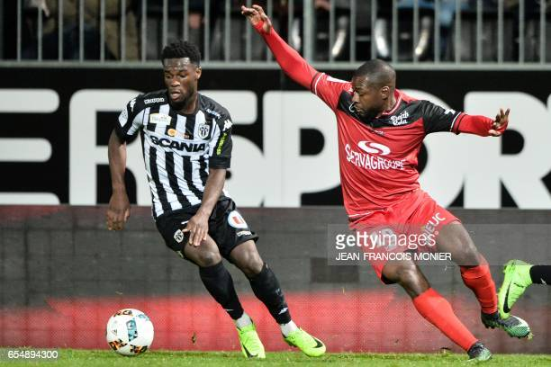 Angers' French forward Jonathan Bamba vies with Guingamp's French midfielder Yannis Salibur during the French L1 football match between Angers and...