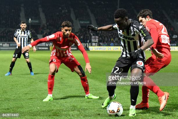 Angers' French forward Jonathan Bamba vies with Nancy's French midfielder Youssef Ait Bennasser and Nancy's French defender Vincent Muratori during...