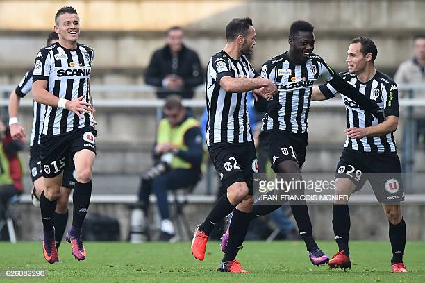 Angers' French forward Nicolas Pepe celebrates with teammates after scoring a goal during the French L1 football match between Angers and...