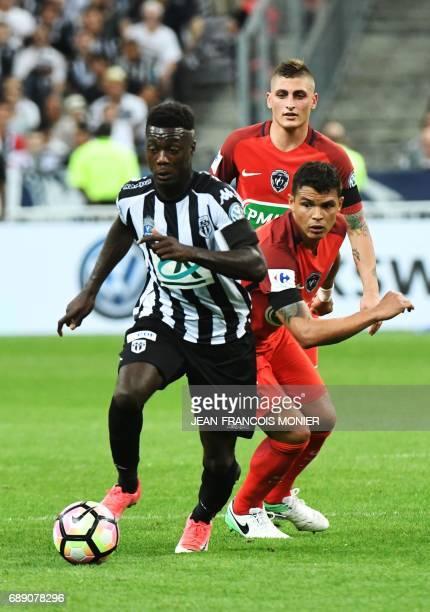 Angers' French forward Nicolas Pepe vies for the ball with Paris SaintGermain's Italian midfielder Marco Verratti and Paris SaintGermain's Brazilian...