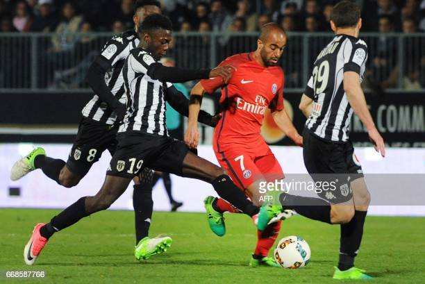 Angers' French forward Pepe Nicolas and Angers' French defender Vincent Manceau vies with Paris SaintGermain's Brazilian midfielder Lucas Moura...