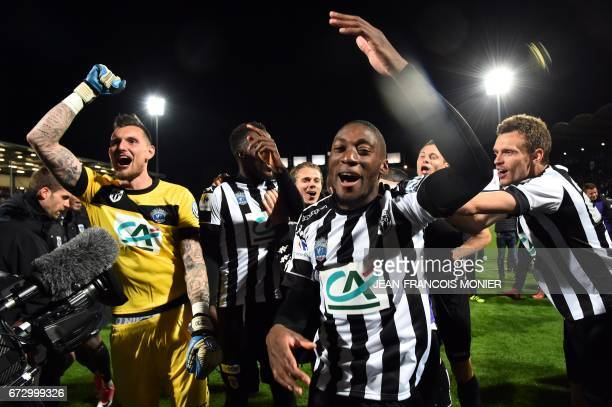 Angers' French goalkeeper Alexandre Letellier and Angers' Cameroun forward Karl Toko Ekambi celebrate after winning the French Cup semifinal match...