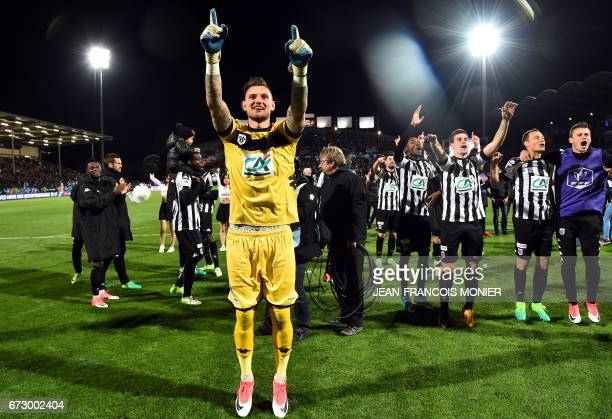 Angers' French goalkeeper Alexandre Letellier and teammates celebrate after winning the French Cup semifinal match between Angers and EA Guingamp on...