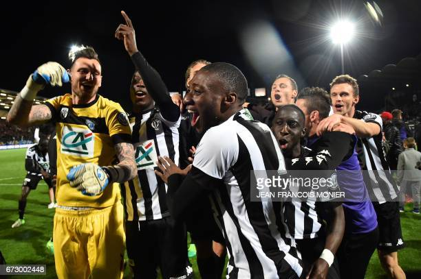 Angers' French goalkeeper Alexandre Letellier Angers' Cameroun forward Karl Toko Ekambi and teammates celebrate after winning the French Cup...