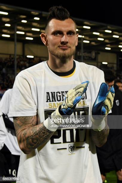 Angers' French goalkeeper Alexandre Letellier applauds at the end of the French L1 football match between Angers and Montpellier on May 20 in...